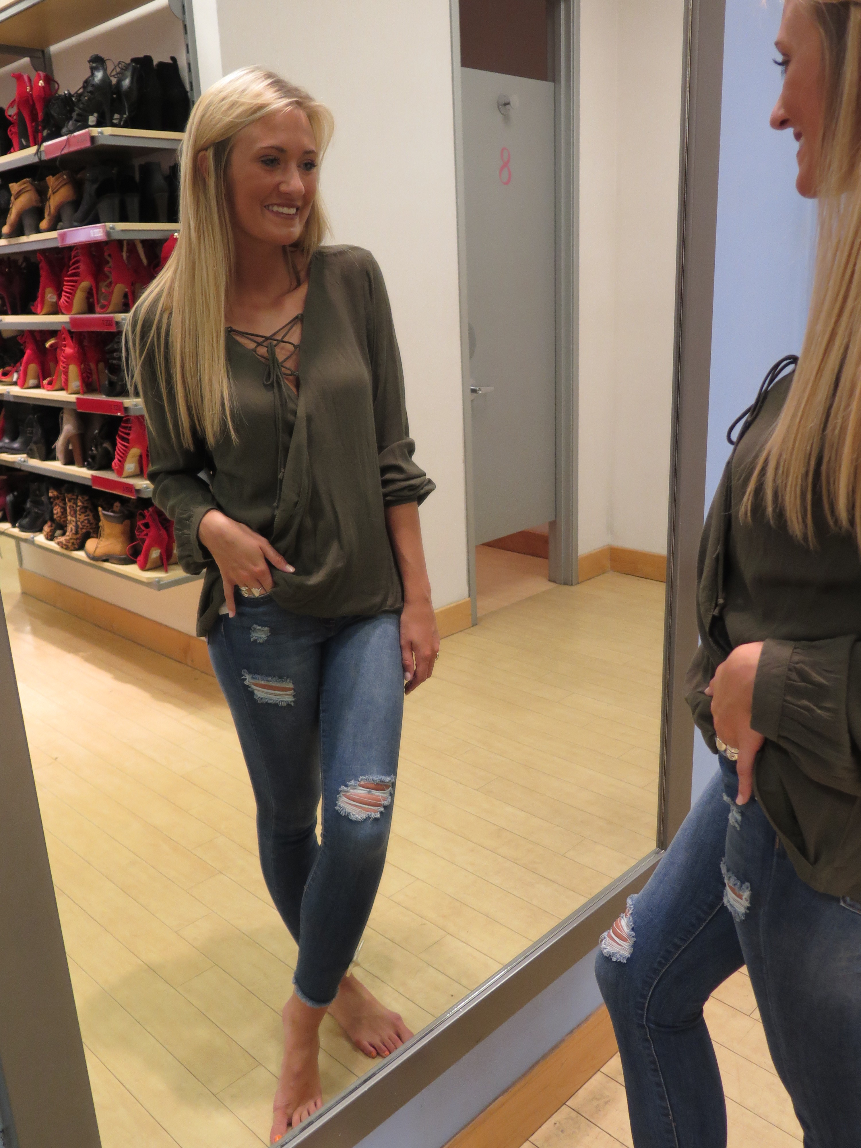 Tanger Outlet Charlotte Russe Outlet lace up army green top, distressed jeans