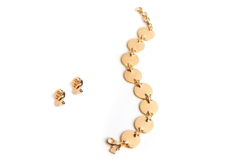 Tanger Outlets gold bracelet and earrings