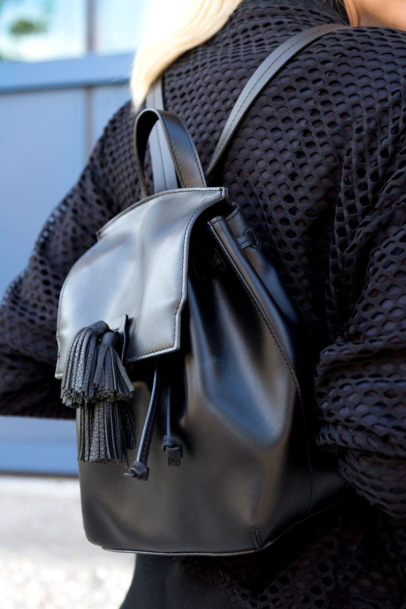 tanger outlets saks off fifth black tassel backpack